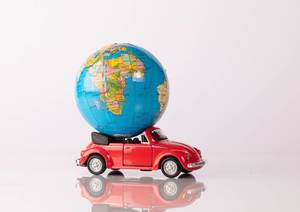 Globe on a red beetle car (Flip 2019)