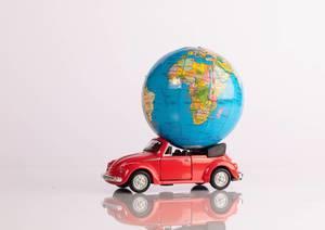 Globe on a red beetle car