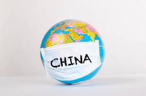 Globe with medical mask and China text