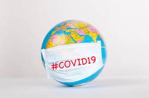 Globe with medical mask on white background with #COVID19 text.jpg