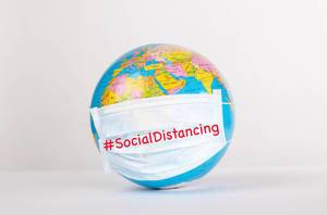 Globe with medical mask on white background with #SocialDistancing text
