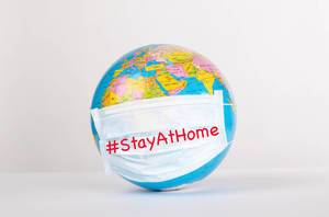 Globe with medical mask on white background with #StayAtHome text