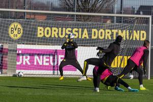 Goalkeeper Marwin Hitz catches the ball during the Borussia Dortmund public training