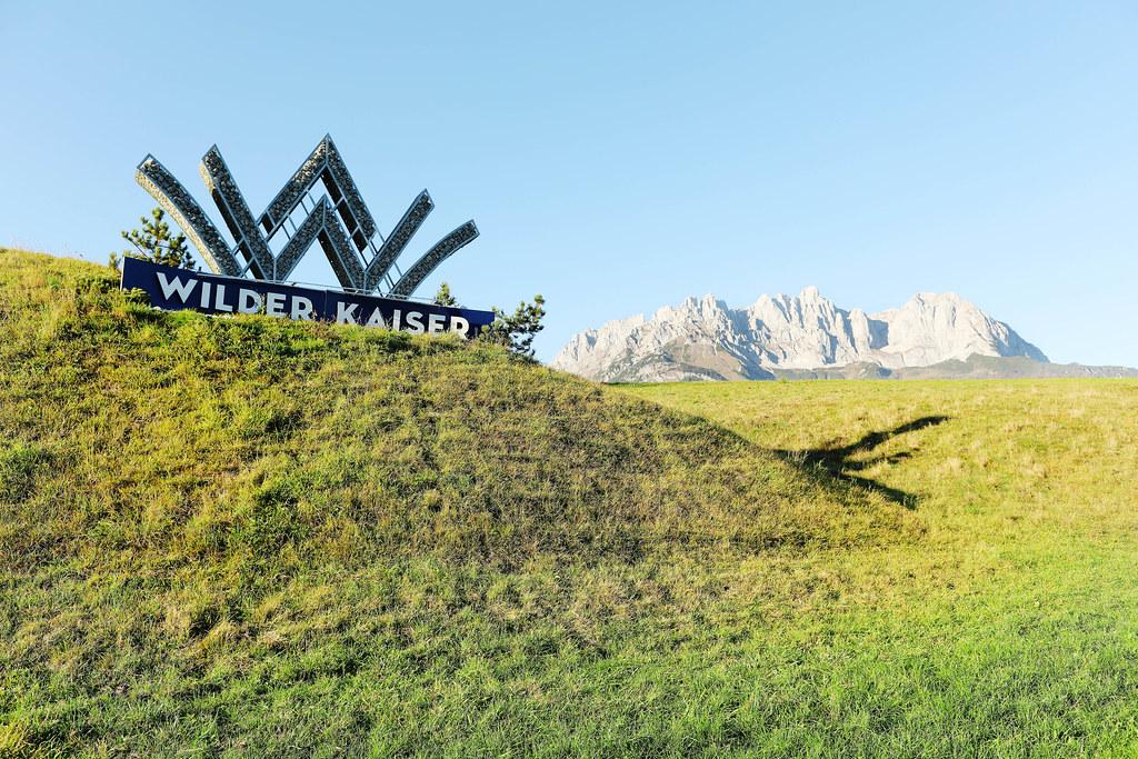 Going am Wilden Kaiser logo with Wilder Kaiser on background, Austria