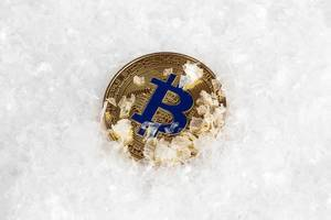 Gold Bitcoin in snow