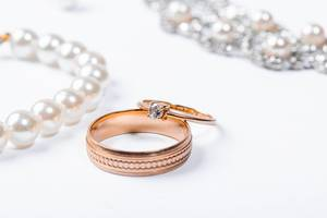 Gold wedding rings on white background