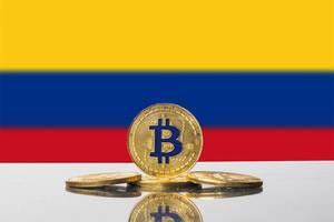 Golden Bitcoin and flag of Colombia