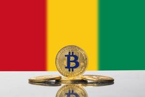 Golden Bitcoin and flag of Guinea