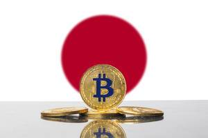 Golden Bitcoin and flag of Japan