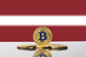 Golden Bitcoin and flag of Latvia
