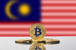 Golden Bitcoin and flag of Malaysia
