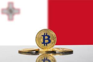 Golden Bitcoin and flag of Malta