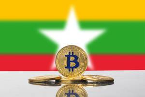 Golden Bitcoin and flag of Myanmar