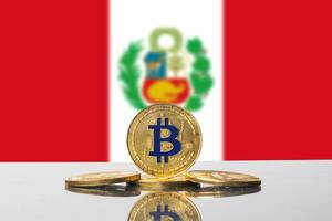Golden Bitcoin and flag of Peru