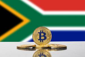 Golden Bitcoin and flag of South Africa