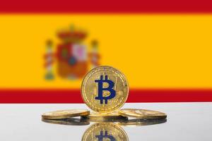 Golden Bitcoin and flag of Spain