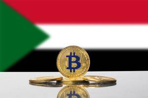 Golden Bitcoin and flag of Sudan