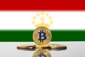 Golden Bitcoin and flag of Tajikistan