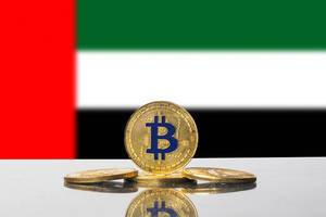Golden Bitcoin and flag of United Arab Emirates