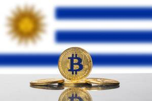 Golden Bitcoin and flag of Uruguay
