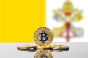 Golden Bitcoin and flag of Vatican City