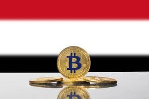 Golden Bitcoin and flag of Yemen
