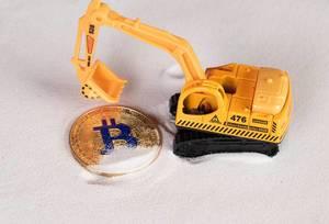 Golden Bitcoin with excavator