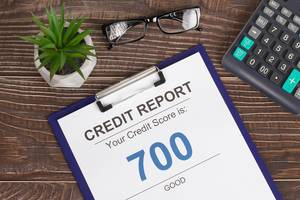 Good credit score report of 700 on wooden desk