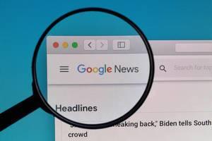 Google News logo under magnifying glass