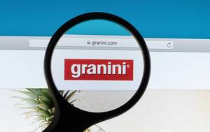 Granini logo under magnifying glass