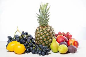 Grapes, pineapple, pears, apples, nectarine, figs and lemons on white background (Flip 2019)