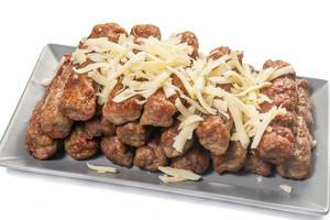 Grated Cheese on the fried Minced Meat Kebabs