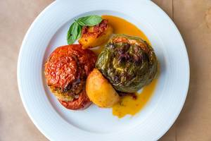 """Greek lunch """"Gemista"""": colorful, stuffed peppers and tomatoes, rice, mint, pine nuts and raisins"""