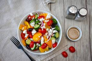 Greek Salad in a White Bowl Top View
