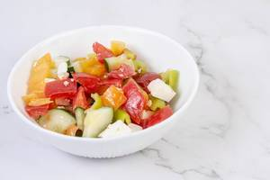 Greek Salad in the bowl above grey marble table (Flip 2019) (Flip 2019)