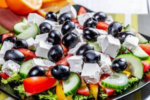Greek salad with fresh vegetables, feta cheese and black olives. Top view  Flip 2019