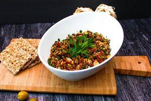 Green Olives Tapenade in a White Bowl with Crackers