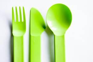 Green plastic cutlery