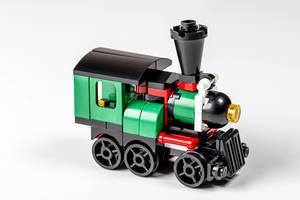 Green plastic train on a white background (Flip 2020)