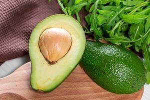Green ripe organic avocado and arugula