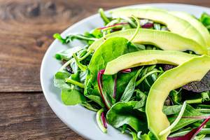 Green salad with salad mix and avocado slices
