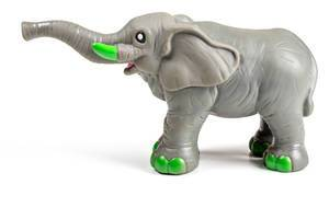 Grey elephant toy on a white background