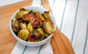 Grilled Brussel Sprout serve in a White Bowl