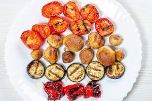Grilled vegetables on a white plate. Top view (Flip 2019)