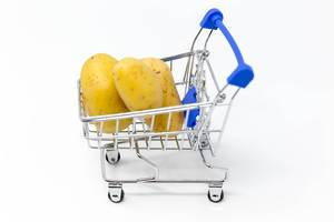 Grocery shopping - potatoes in a shopping cart
