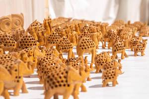 Group of handmade little wooden elephant souvenirs (Flip 2019)