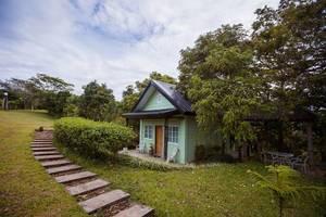 Grünes Ferienhäuschen in gepflegtem Garten in Salvador Benedicto,  Philippinen