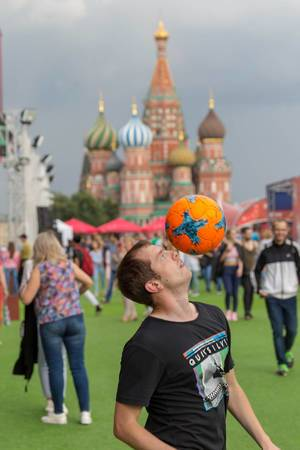 Guy balancing a soccer ball on his head. Saint Basil
