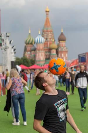 Guy balancing a soccer ball on his head. Saint Basil