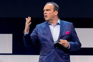 Hagen Rickmann, Director for Business Customers of the Deutsche Telekom and Digital X patron, gives a keynote speech on the stage of the Koelnmesse